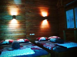 A bed or beds in a room at NAYYLA Homestay