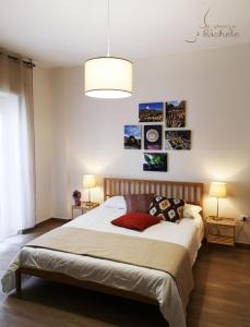 A bed or beds in a room at La Stanza di Rachele