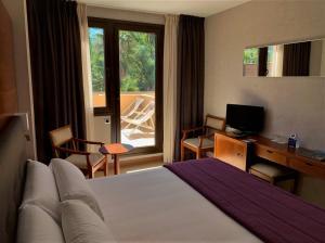 Cama o camas de una habitación en Hotel Balneario Valle del Jerte