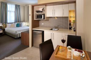 A kitchen or kitchenette at Best Western Plus Hotel Stellar