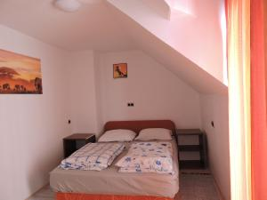 A bed or beds in a room at Apartments Gubanec