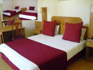 Uma cama ou camas num quarto em Hotel Solneve