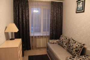 A bed or beds in a room at Ekaterina Apartments