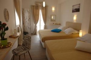 Un ou plusieurs lits dans un hébergement de l'établissement Kalipso villas