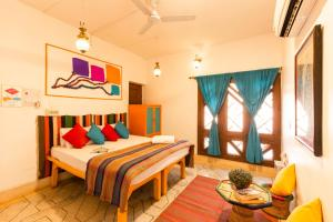 A bed or beds in a room at goSTOPS Varanasi