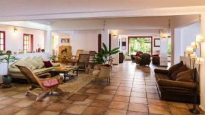 Coin salon dans l'établissement Villa Laurina