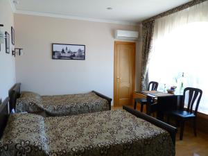 Кровать или кровати в номере Nika Hotel Barnaul