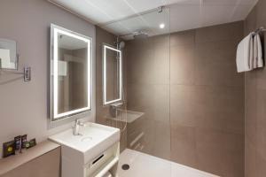 Ein Badezimmer in der Unterkunft Novotel Amsterdam City