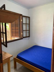 A bed or beds in a room at Flats Alto das Pedras