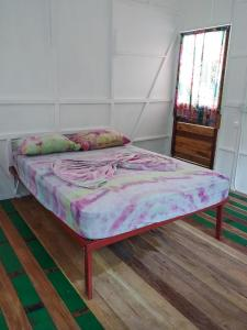 A bed or beds in a room at Rocking J's