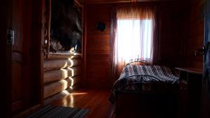 Кровать или кровати в номере Guest House Usadba Okhotnika