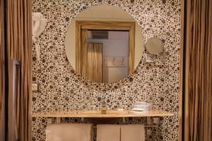 A bathroom at Mola Park Atiram Hotel
