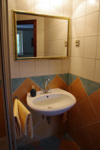 Ein Badezimmer in der Unterkunft La Petite Provence