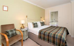 A bed or beds in a room at Three Ways House Hotel; BW Signature Collection