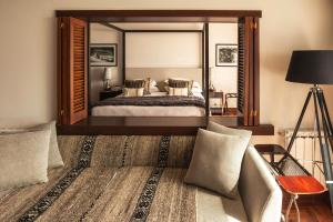 A bed or beds in a room at Hotel Panamericano Bariloche