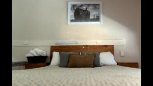A bed or beds in a room at Black Forest Motel
