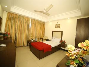 A bed or beds in a room at Hotel Rajavihar