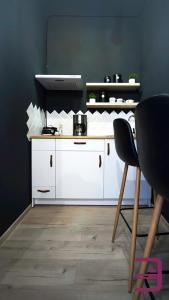 A kitchen or kitchenette at InVerve Hostel