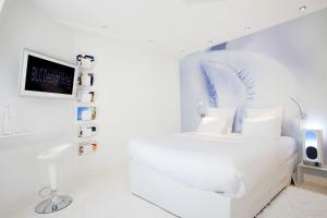 A bed or beds in a room at Blc Design Hotel