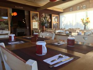 A restaurant or other place to eat at Hotel Les Ambres