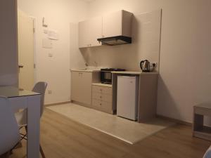 A kitchen or kitchenette at Marianna Annex