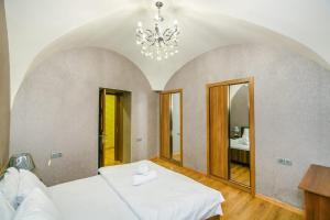 Cama ou camas em um quarto em Oscar Deluxe