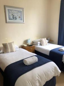 A bed or beds in a room at green tree hotel