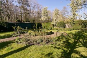 Ein Garten an der Unterkunft Hotel Randduin