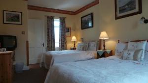 Un ou plusieurs lits dans un hébergement de l'établissement Inishmore House