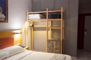 A bunk bed or bunk beds in a room at Hotel Erika