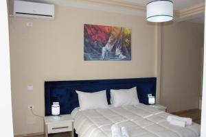 Ліжко або ліжка в номері Sunrise Hotel