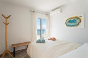 Säng eller sängar i ett rum på Seafront Penthouse LEO