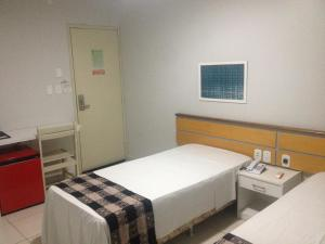 A bed or beds in a room at Hotel Sol Nascente