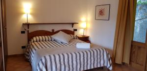 A bed or beds in a room at Borgo San Francesco