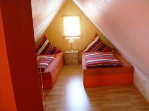 Ein Bett oder Betten in einem Zimmer der Unterkunft Pension Fitnessoase