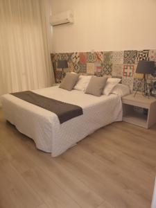 A bed or beds in a room at Marianna Annex