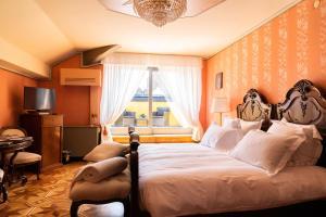 Een bed of bedden in een kamer bij Relais & Chateaux Villa Crespi