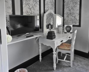 A television and/or entertainment center at Glenfall House and Coach House