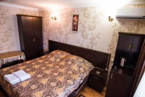 Кровать или кровати в номере Hotel Sport