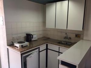 A kitchen or kitchenette at Sunflower Hotel Apartments