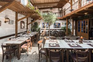 A restaurant or other place to eat at Koukos Rhodian Guesthouse - Adults Only