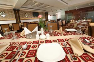 A restaurant or other place to eat at PEARL ROYAL INTERNATIONAL HOTELS & RESORTS PVT LTD