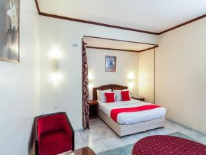 Cama ou camas em um quarto em OYO 146 Al Asemah Hotel