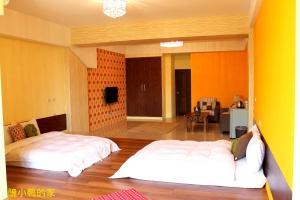 A bed or beds in a room at 雁窩Goose Nest