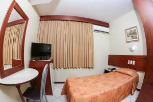 Кровать или кровати в номере Hotel Express Mauá
