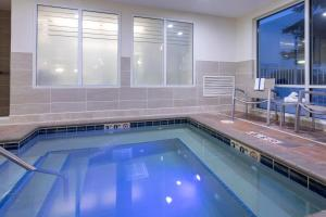 The swimming pool at or near SpringHill Suites Rochester Mayo Clinic Area / Saint Marys