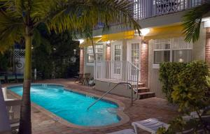 The swimming pool at or near Pass-a-Grille Coconut Inn