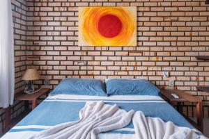 A bed or beds in a room at Pousada Canto das Trilhas