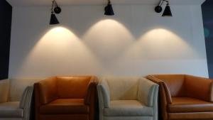 A seating area at 18 Coins Cafe & Hostel