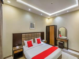 Cama ou camas em um quarto em فندق دوتيل للشقق الفندقية Dotel